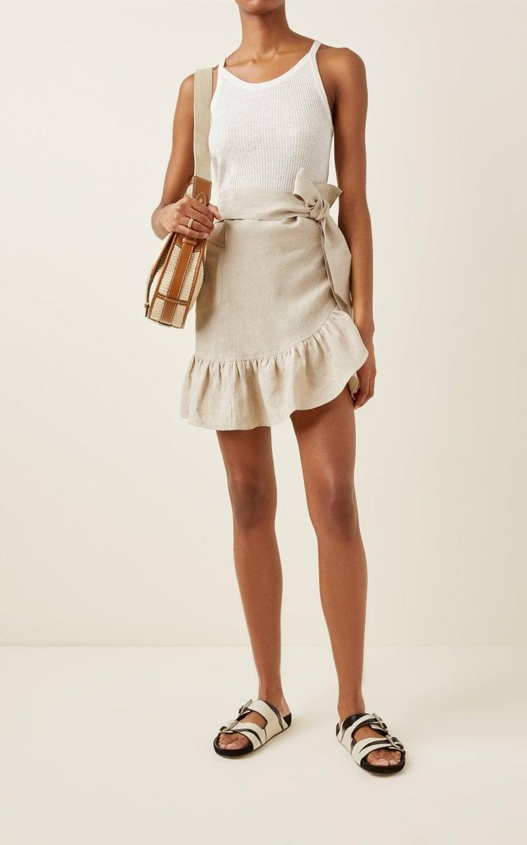 """<p>""""I am more than ready for springtime, and I'm really loving the neutral shade of this cute <span>Isabel Marant Étoile Tempster Ruffled Linen Mini Wrap Skirt</span> ($395). I'll pair it with a white tank and some dangly earrings."""" - IY</p>"""