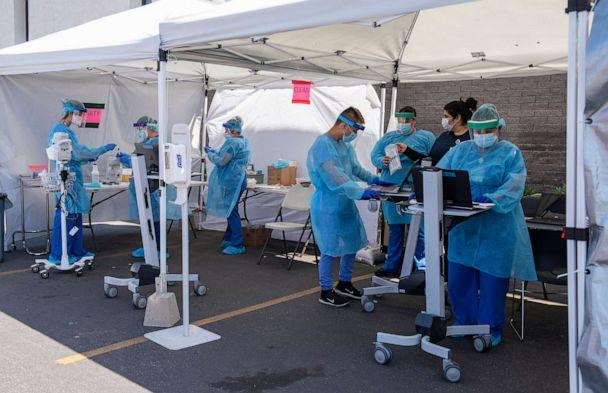 PHOTO: Medical personnel from AltaMed collect COVID-19 tests from drive-through patients at their clinic on Bristol Street in Santa Ana, Calif., April 21, 2020. (Leonard Ortiz/Orange County Register via MediaNews Group via Getty Images)
