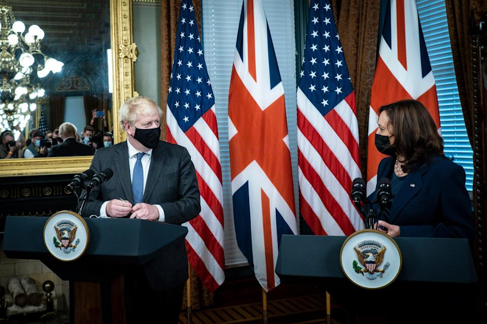US Vice President Kamala Harris (R) and British Prime Minister Boris Johnson deliver remarks before a meeting, in the Vice President's Ceremonial Office in Washington, DC (EPA)