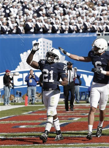 Penn State wide receiver Derek Moye (6) congratulates tailback Stephfon Green (21) after he scored a touchdown against Houston during the first half of the TicketCity Bowl NCAA college football game, Monday, Jan. 2, 2012, at the Cotton Bowl in Dallas. (AP Photo/Brandon Wade)