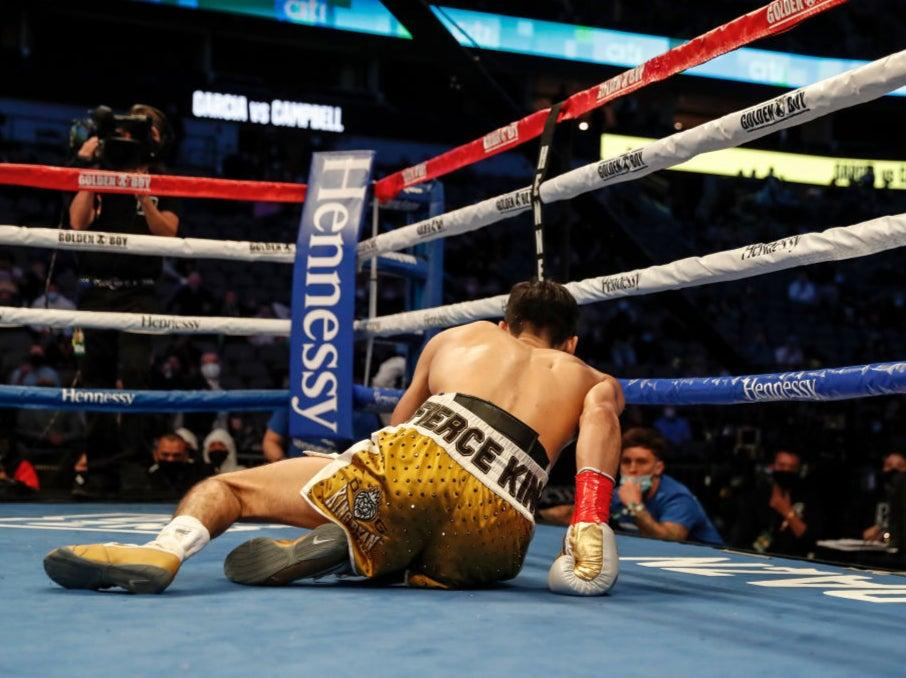<p>Ryan Garcia is knocked to the canvas in the second round</p>Getty Images