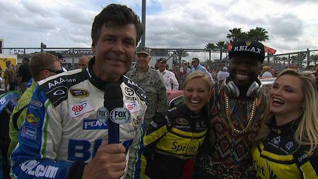 50 Cent's willing to kiss pretty much anybody at the Daytona 500 at this point