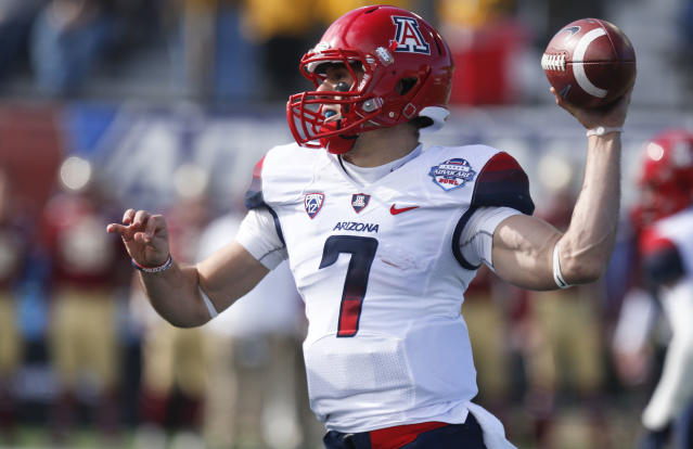 Arizona quarterback B.J. Denker (7) throws a pass against Boston College during the first half of the AdvoCare V100 Bowl NCAA college football game, Tuesday, Dec. 31, 2013, at Independence Stadium in Shreveport, La. (AP Photo/Rogelio V. Solis)