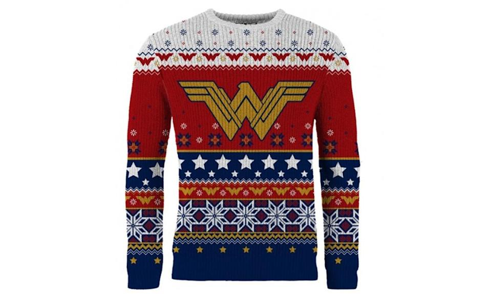 """<p>Nothing ugly about it, but we'd still wear it to every appropriate ugly Christmas sweater occasion on our holiday calendar. <strong><a rel=""""nofollow noopener"""" href=""""https://www.merchoid.com/product/wonder-woman-winter-wonder-land-christmas-sweater-jumper/"""" target=""""_blank"""" data-ylk=""""slk:Buy here"""" class=""""link rapid-noclick-resp"""">Buy here</a></strong> </p>"""