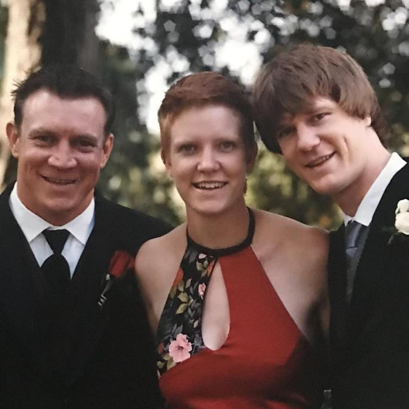 Dean poses with his sister and brother at his first wedding and just check out that hair. Source: Instagram/deanwells