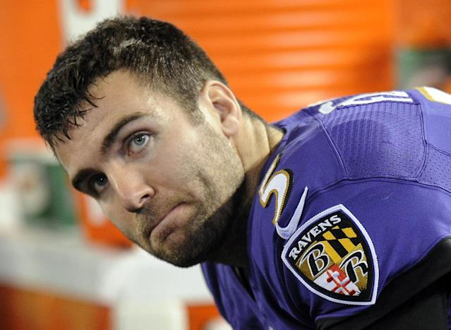 Baltimore Ravens quarterback Joe Flacco sits on the sideline in the second half of an NFL football game against the New England Patriots, Sunday, Dec. 22, 2013, in Baltimore. (AP Photo/Nick Wass)