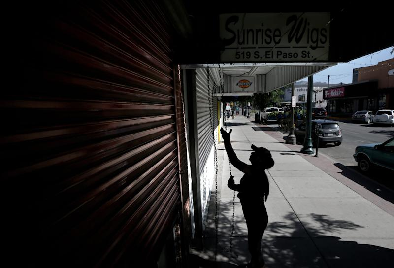 EL PASO, Texas – Elsa Arrambide, co-owner of Sunrise Wigs in downtown El Paso, opens her shop Sunday morning on a popular shopping street for border crossers. Arrambide says business is way down as long lines have become the norm on the Paso del Norte International Bridge only a few block south.