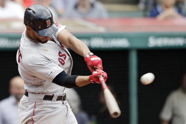 Boston Red Sox's Xander Bogaerts hits a three-run home run in the seventh inning during a baseball game against the Cleveland Indians, Wednesday, Aug. 14, 2019, in Cleveland. (AP Photo/Tony Dejak)