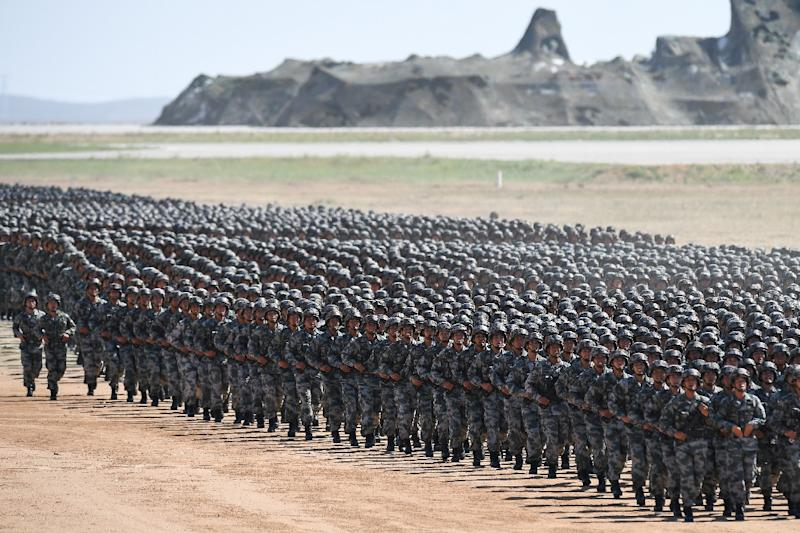 Chinese soldiers march at the Zhurihe training base in China's northern Inner Mongolia region last year