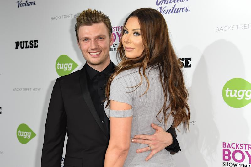 "Nick Carter, left, and Lauren Kitt arrive at the ""Backstreet Boys: Show 'Em What You're Made Of"" premiere at the Arclight Cinemas - Cinerama Dome on Thursday, Jan. 29, 2015, in Los Angeles. (Photo by Rob Latour/Invision/AP)"