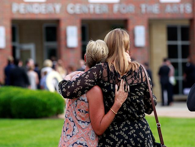 <p>Mourners stand outside the art center before a funeral service for Otto Warmbier, who died after his release from North Korea, at Wyoming High School in Wyoming, Ohio, June 22, 2017. (Photo: John Sommers II/Reuters) </p>