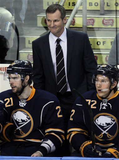 Buffalo Sabres interim coach James Patrick watches during the third period of the Sabres' 6-0 win over the Boston Bruins in an NHL hockey game in Buffalo, N.Y., Wednesday, Feb. 8, 2012. Coach Lindy Ruff was injured Monday and watched the game from the coaches' box. (AP Photo/David Duprey)