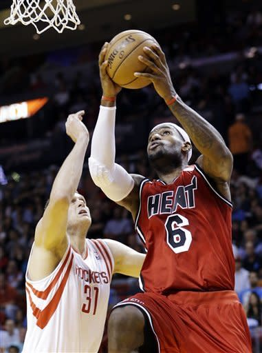 Miami Heat forward LeBron James (6) shoots against Houston Rockets center Cole Aldrich (31) during the first half of an NBA basketball game, Wednesday, Feb. 6, 2013, in Miami. (AP Photo/Wilfredo Lee)