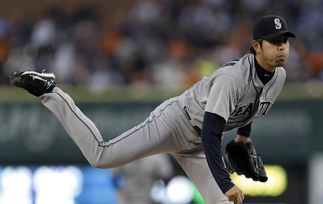 Seattle Mariners starting pitcher Hisashi Iwakuma, of Japan, throws against the Detroit Tigers in the first inning of a baseball game in Detroit, Wednesday, Sept. 18, 2013. (AP Photo/Paul Sancya)