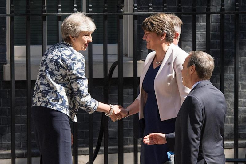 Smiles: Theresa May greets DUP leader Arlene Foster at No 10 in June last year(PA)