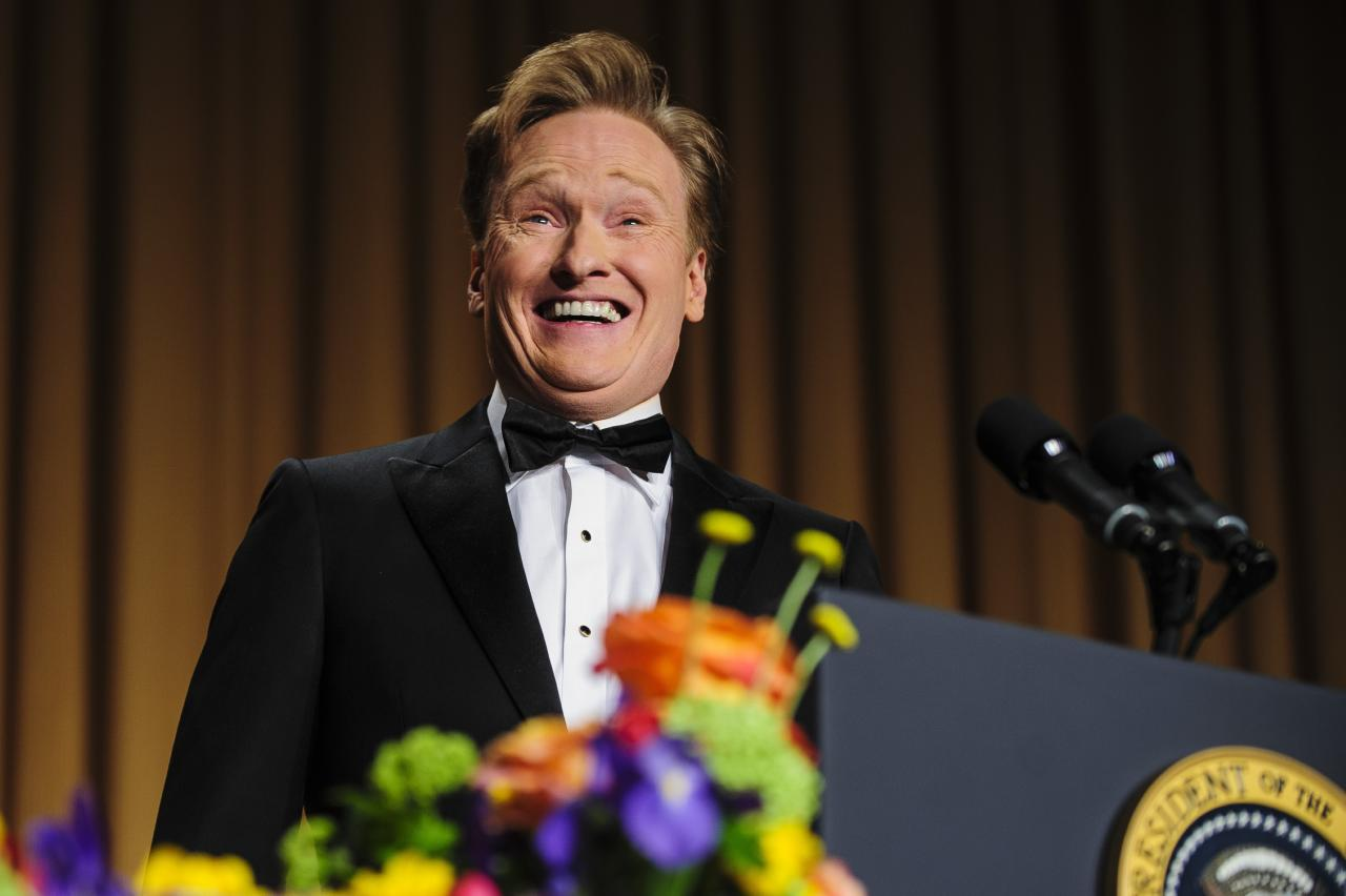 WASHINGTON, DC - APRIL 27:  Comedian Conan O'Brien delivers a comedy routine during the White House Correspondents' Association Dinner on April 27, 2013 in Washington, DC. The dinner is an annual event attended by journalists, politicians and celebrities. (Photo by Pete Marovich-Pool/Getty Images)