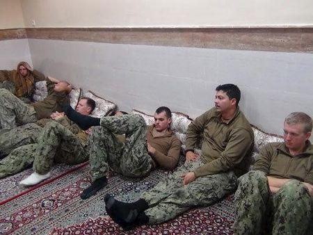 An undated picture released by Iran's Revolutionary Guards website shows American sailors sitting in an unknown place in Iran. REUTERS/sepahnews.ir/TIMA/Handout via Reuters