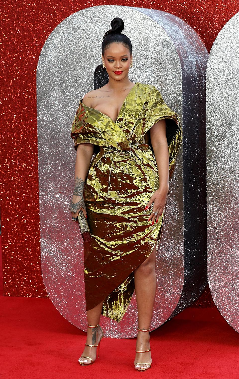 <p>Rihanna worked a crinked, gold dress by French couture house Poiret. <em>[Photo: Getty]</em> </p>