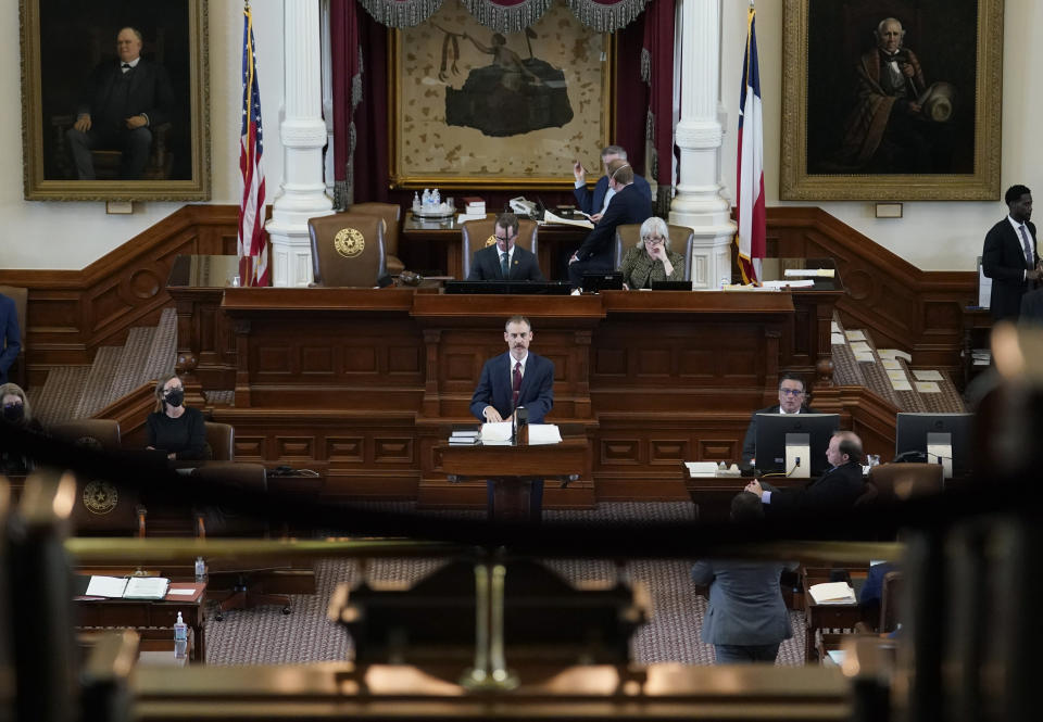 Texas State Rep. Andrew Murr, R-Kerrville, center, answers questions of fellow lawmakers as they debate voting bill SB1 in the House Chamber at the Texas Capitol, Thursday, Aug. 26, 2021, in Austin, Texas. (AP Photo/Eric Gay)