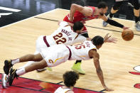 Chicago Bulls guard Zach LaVine, top, battles for a loose ball against Cleveland Cavaliers forward Larry Nance Jr., center, and Cleveland Cavaliers forward Isaac Okoro during the second half of an NBA basketball game in Chicago, Wednesday, March 24, 2021. The Cleveland Cavaliers won 103-94. (AP Photo/Nam Y. Huh)