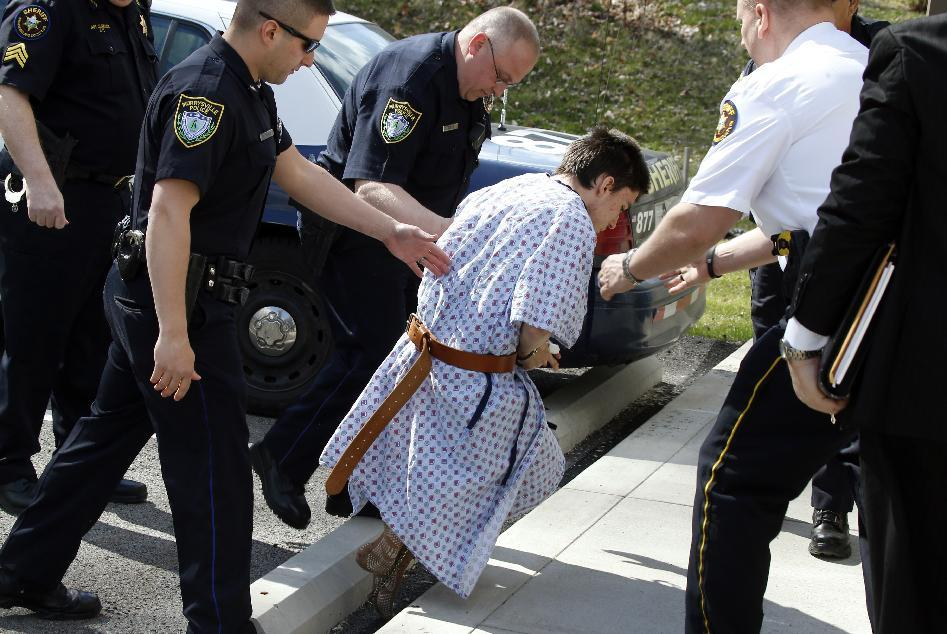 Alex Hribal, the suspect in the multiple stabbings at the Franklin Regional High School in Murrysville, Pa., stumbles as he is escorted by police to a district magistrate to be arraigned on Wednesday, April 9, 2014, in Export, Pa. Authorities say Hribal has been charged after allegedly stabbing and slashing at least 19 people, mostly students, in the crowded halls of his suburban Pittsburgh high school Wednesday. (AP Photo/Keith Srakocic)