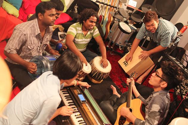 (From left) Osman, Getun and Jahangir practice with three of the Singaporean musicians during the first recording session for the music video. (Photo courtesy of Bernice Wong)