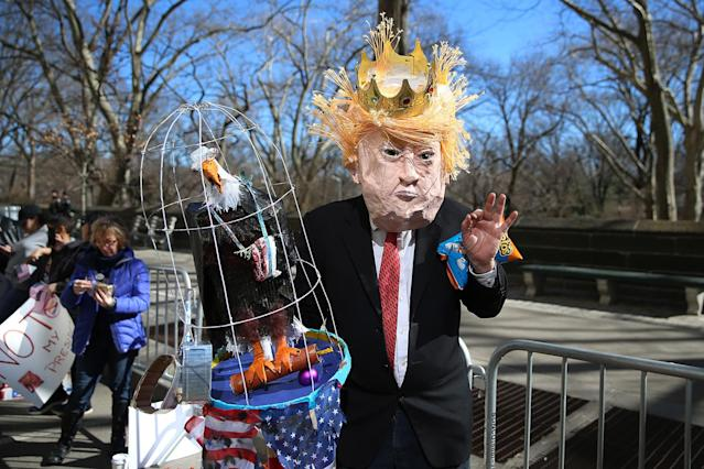 "<p>A demonstrator dressed as Donald Trump poses for photos before the ""Not My President's Day"" rally on Central Park West in New York City on Feb. 20, 2017. (Photo: Gordon Donovan/Yahoo News) </p>"
