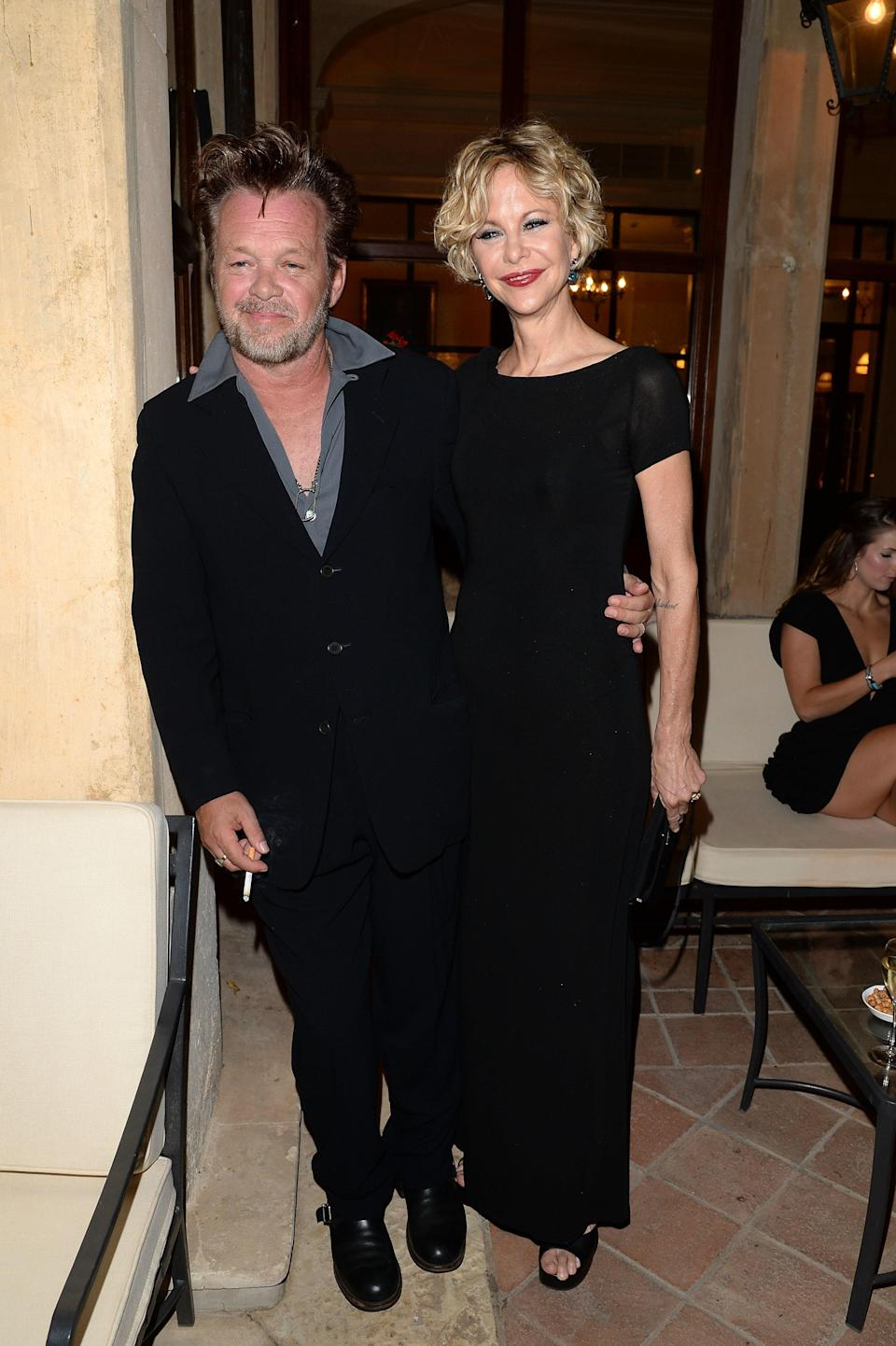 """A year after announcing their engagement, John Mellencamp and Meg Ryan have split up, <a href=""""https://people.com/movies/meg-ryan-and-john-mellencamp-split-after-engagement-he-didnt-want-to-get-married-again/?utm_medium=browser&utm_source=people.com&utm_content=20191104&utm_campaign=457711"""" rel=""""nofollow noopener"""" target=""""_blank"""" data-ylk=""""slk:People"""" class=""""link rapid-noclick-resp""""><em>People</em></a> confirms. """"He didn't want to get married again,"""" a source tells the outlet. """"He loves her, but marriage never seemed to be a part of it. It's unclear how important a marriage was to Meg. But they spent a lot of time together, and it's too bad they split. They really got along so well together."""" The couple first started dating back in 2011 and were on and off for a few years before getting engaged."""