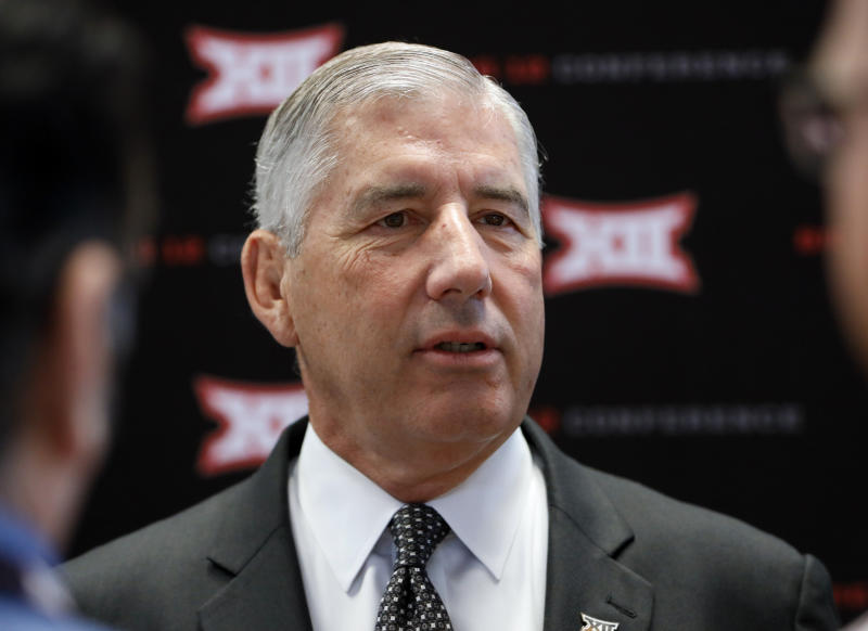 Conference commissioner Bob Bowlsby answers questions from reporters after his opening remarks on the first day of Big 12 Conference NCAA college football media days Monday, July 15, 2019, at AT&T Stadium in Arlington, Texas. (AP Photo/David Kent)