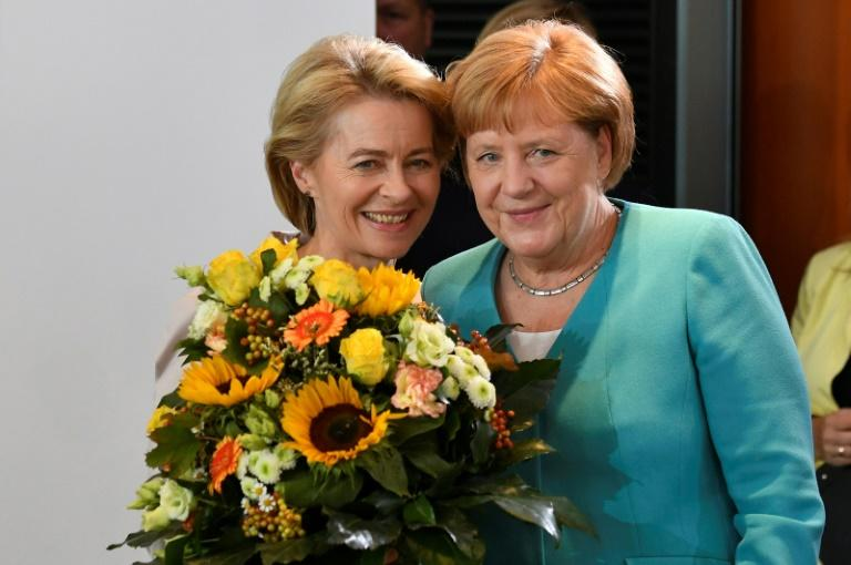 EU president-elect  Ursula von der Leyen, seen posing in Berlin with Angela Merkel, won a wafetr-thin majority -- a weak foundation from which to unite an increasingly fragmented Europe