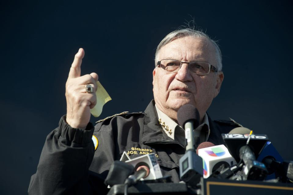 Maricopa County Sheriff Joe Arpaio announces newly launched program aimed at providing security around schools in Anthem, Arizona in this file photo taken January 9, 2013. A U.S. judge who twice chastised Arpaio over his office's misrepresenting a ruling aimed at quashing racial profiling said on Wednesday the lawman was complying with an order requiring employees to be educated on the issue. REUTERS/Laura Segall/Files (UNITED STATES - Tags: CRIME LAW EDUCATION SOCIETY)