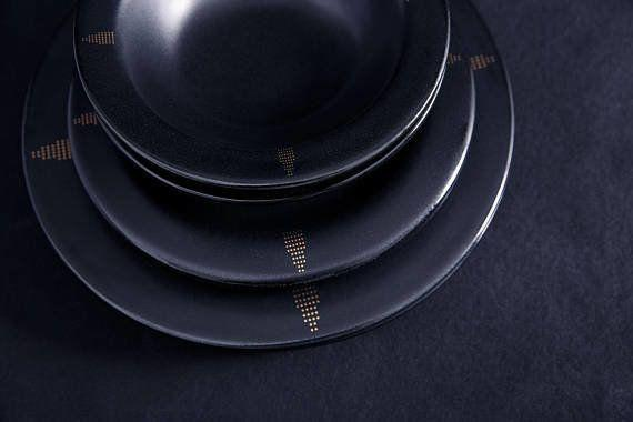 "<a href=""https://www.etsy.com/listing/552658349/black-porcelain-dinner-plate-with-22k"" target=""_blank"">Get them here</a>."
