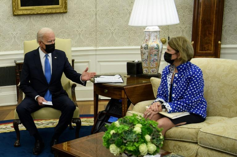 Shelley Moore Capito (right) is among a group of Republican Senators negotiating with US President Joe Biden (left) over his infrastructure bill