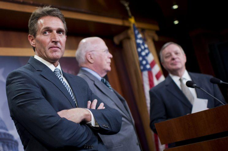 From left, Jeff Flake, R-Ariz., Patrick Leahy, D-Vt., and Minority Whip Richard Durbin, D-Ill., conduct a news conference in the Capitol's Senate studio on legislation that would end the U.S. travel ban on Cuba, January 29, 2015. (Photo: Tom Williams/CQ Roll Call)