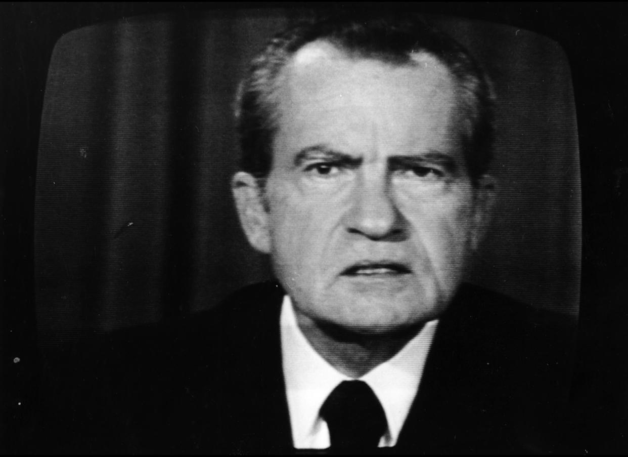President Richard Nixon wants to require employers to cover their workers and create federal subsidies to help everyone else buy private insurance. The Watergate scandal intervenes.