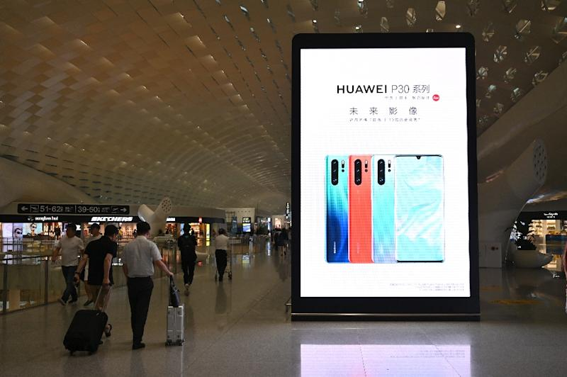 Chinese telecoms giant Huawei currently provides the most advanced -- and least expensive -- 5G technology in the world (AFP Photo/HECTOR RETAMAL)