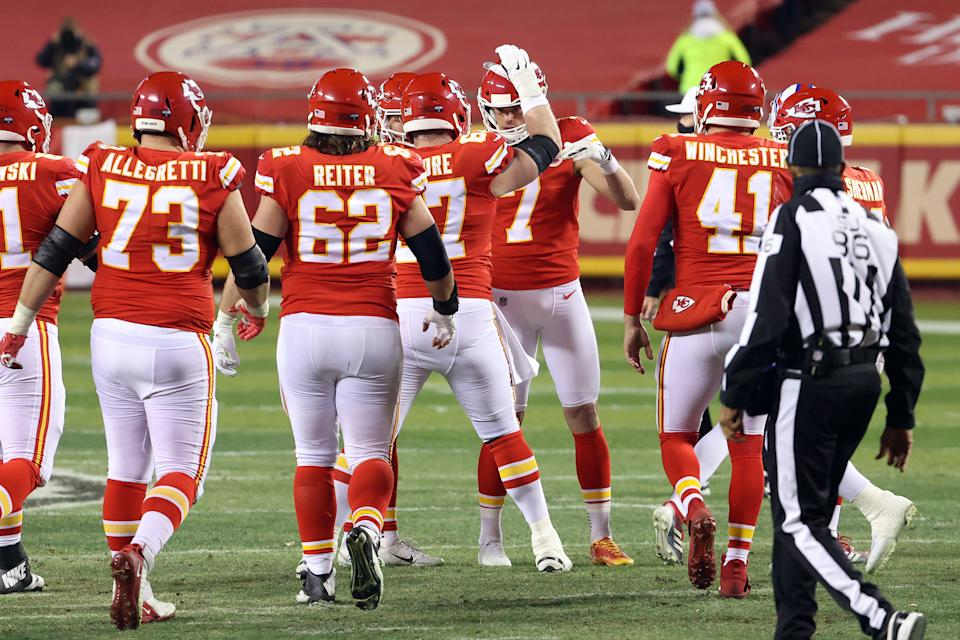 KANSAS CITY, MISSOURI - JANUARY 24: Harrison Butker #7 of the Kansas City Chiefs celebrates with teammates after kicking a field goal in the third quarter against the Buffalo Bills during the AFC Championship game at Arrowhead Stadium on January 24, 2021 in Kansas City, Missouri. (Photo by Jamie Squire/Getty Images)