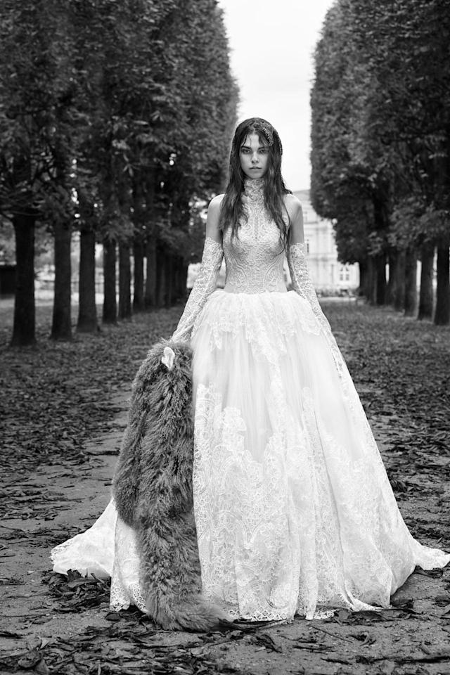 <p><i>Long-sleeve macramé lace ball gown with high neck accent and couture hand-draped skirt. (Photo: Courtesy of Vera Wang/Patrick Demarchelier) </i></p>