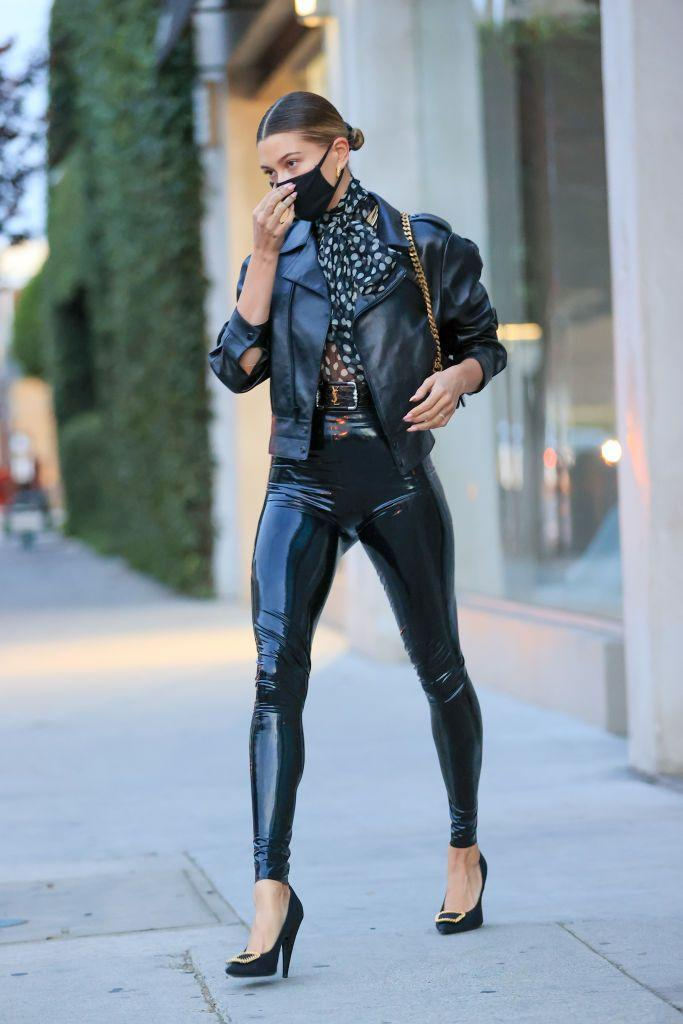 "<p>Bieber looked ready to rock out in L.A in a leather cropped jacket, and a pair of skintight latex leggings by Saint Laurent. To soften the look, the 24-year-old paired the edgy ensemble with a pussy bow blouse and a low bun. </p><p><a class=""link rapid-noclick-resp"" href=""https://go.redirectingat.com?id=127X1599956&url=https%3A%2F%2Fwww.net-a-porter.com%2Fen-gb%2Fshop%2Fproduct%2Fsaint-laurent%2Flatex-leggings-latex-care-cleaning-kit-3-x-30ml-bottles-vividress-vivishine-viviclean%2F1283404&sref=https%3A%2F%2Fwww.elle.com%2Fuk%2Ffashion%2Fcelebrity-style%2Farticles%2Fg31247%2Fhailey-baldwin-fashion-style-file%2F"" rel=""nofollow noopener"" target=""_blank"" data-ylk=""slk:SHOP HAILEY'S LEGGINGS"">SHOP HAILEY'S LEGGINGS</a></p>"