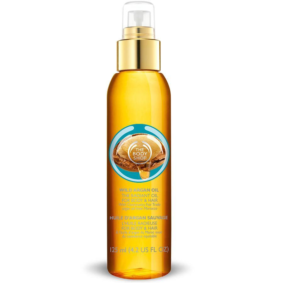 """<p>Community fair trade wild argan oil from Morocco is used to add radiance and shine anywhere you spray it. It has a mild scent and goes on smooth, not sticky. <a href=""""http://www.thebodyshop-usa.com/bath-body-care/body-massage-oils/wild-argan-oil-the-radiant-oil-for-body-hair.aspx"""" rel=""""nofollow noopener"""" target=""""_blank"""" data-ylk=""""slk:The Body Shop Wild Argan Oil The Radiant Oil for Body & Hair"""" class=""""link rapid-noclick-resp"""">The Body Shop Wild Argan Oil The Radiant Oil for Body & Hair</a> ($25)</p><p>Source: The Body Shop<br></p>"""