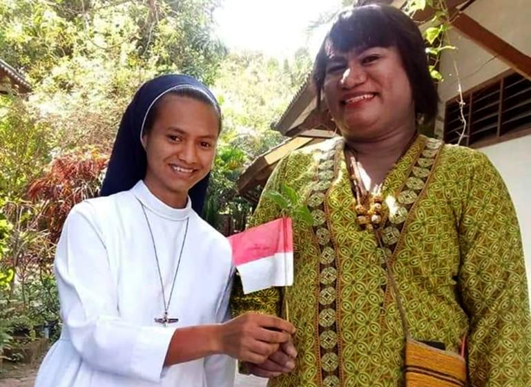 Hendrika Mayora Victoria Kelan (right), a former Catholic brother, remains active in her local parish.
