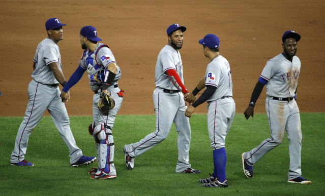 Players for the Texas Rangers celebrate after their baseball game against the Kansas City Royals Monday, June 18, 2018, in Kansas City, Mo. The Rangers won 6-3. (AP Photo/Charlie Riedel)
