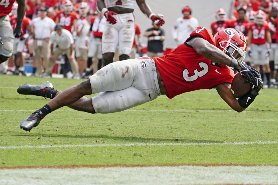 Georgia running back Zamir White (3) dives over the goal line to score a touchdown during the second half of an NCAA college football game against Arkansas Saturday, Oct. 2, 2021, in Athens, Ga. (AP Photo/John Bazemore)