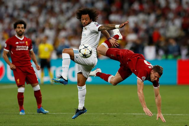 Soccer Football - Champions League Final - Real Madrid v Liverpool - NSC Olympic Stadium, Kiev, Ukraine - May 26, 2018 Real Madrid's Marcelo in action with Liverpool's James Milner REUTERS/Andrew Boyers TPX IMAGES OF THE DAY