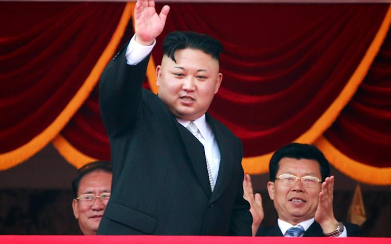 Dictator Kim Jong-Un salutes his armed forces - Credit: How Hwee Young/EPA