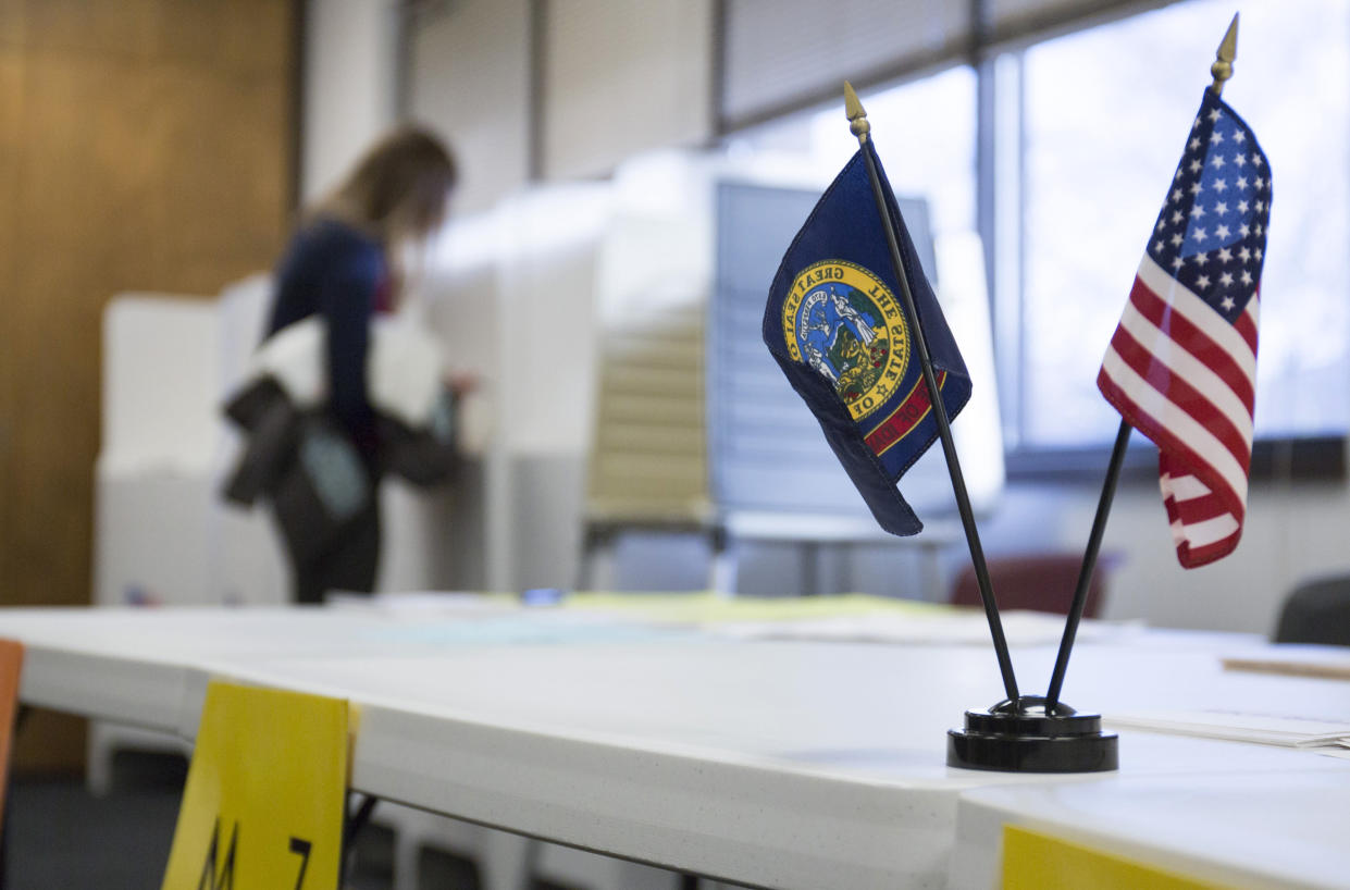 A voter fills out a ballot at the Boise Senior Center during the primary election in Boise, Idaho in 2016. (Otto Kitsinger/AP)