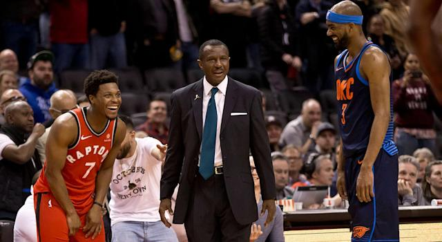 Kyle Lowry, Dwane Casey and Corey Brewer react in amazement to Casey's ejection. (Lucas Oleniuk/Toronto Star via Getty Images)