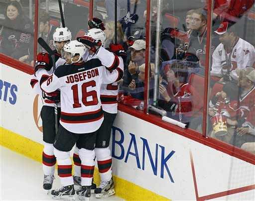 Jacob Josefson (16), of Sweden, and Steve Bernier (18) congratulate teammate Ryan Carter (20) on his goal during the second period of an NHL hockey game against the Carolina Hurricanes in Raleigh, N.C., Saturday, March 31, 2012. (AP Photo/Karl B DeBlaker)