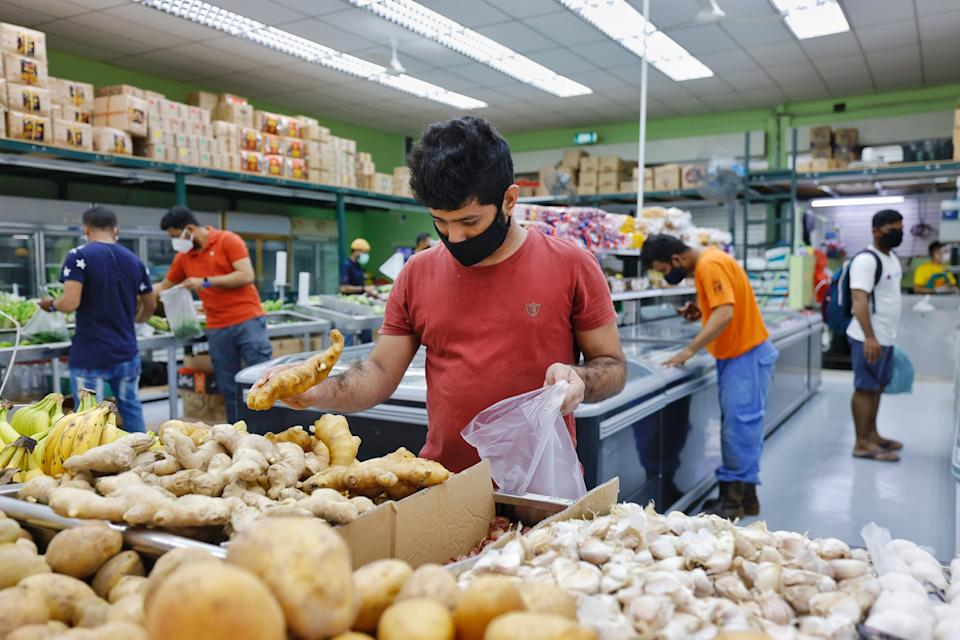 Migrant workers at Tuas South Recreation Centre. (PHOTO: Ministry of Manpower)
