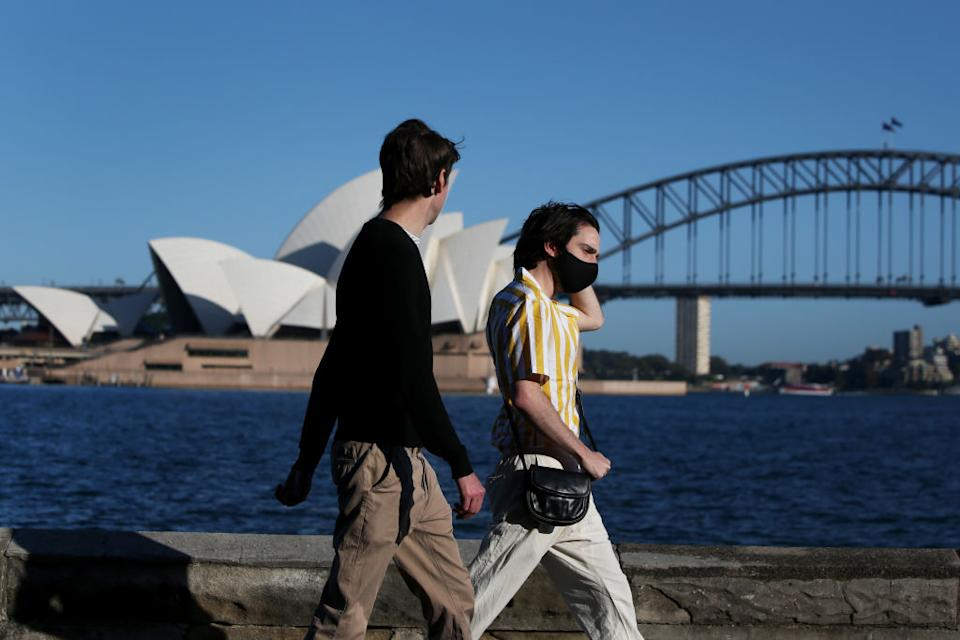 People are seen exercising along the Sydney Harbour shorefront in Sydney, Australia.